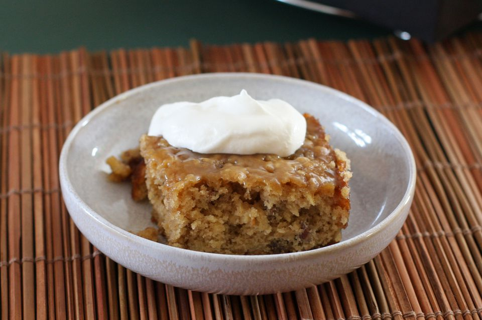 Moist Apple Cake With Raisins And Nuts With Caramel Icing