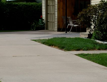 Pros and cons of a tar and chip driveway what are your choices for driveway materials solutioingenieria Image collections