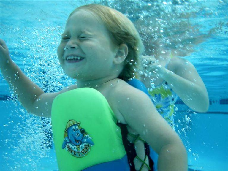 Swimmer in Flotation Device