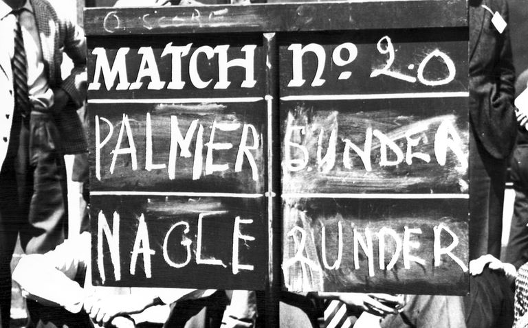 A scoreboard showing Arnold Palmer and Kel Nagle scores during 1962 British Open