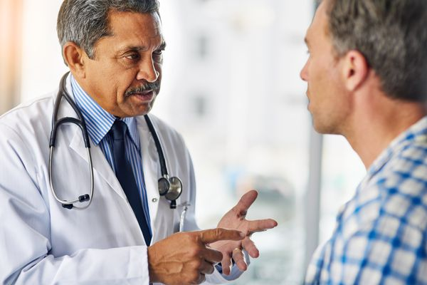Doctor talking to patient.