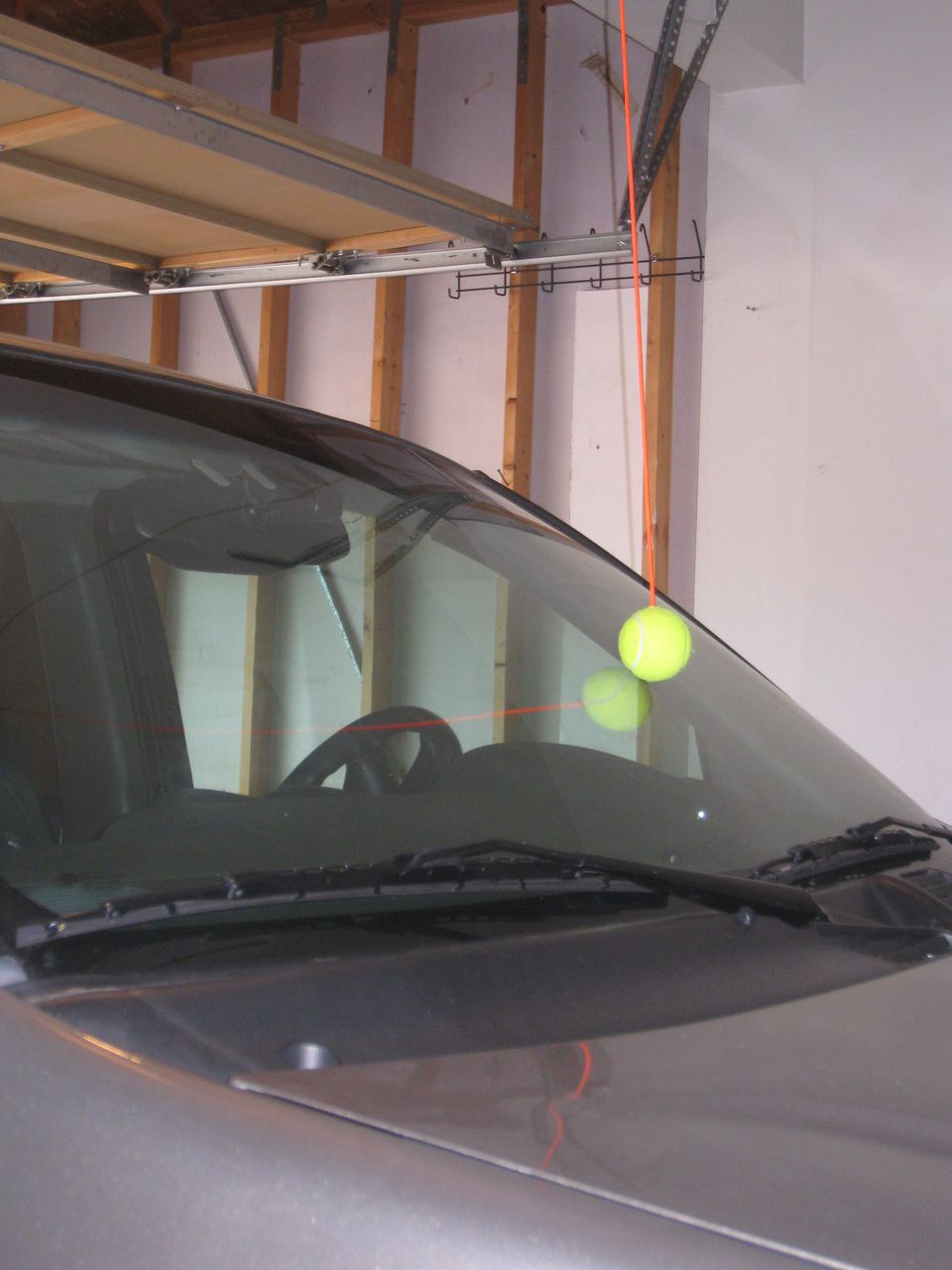 Tennis ball parking aid