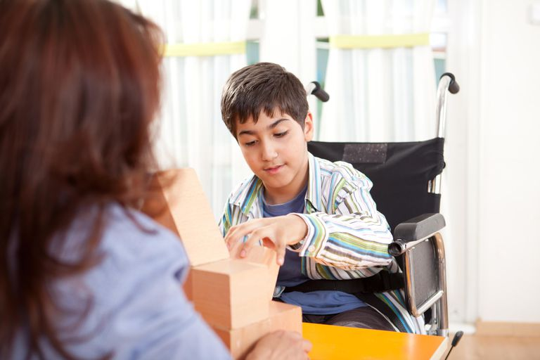 Physical therapy with a disabled child