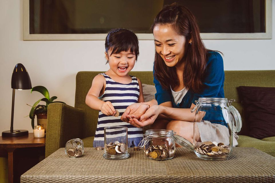 A picture of a mom and daughter sorting money