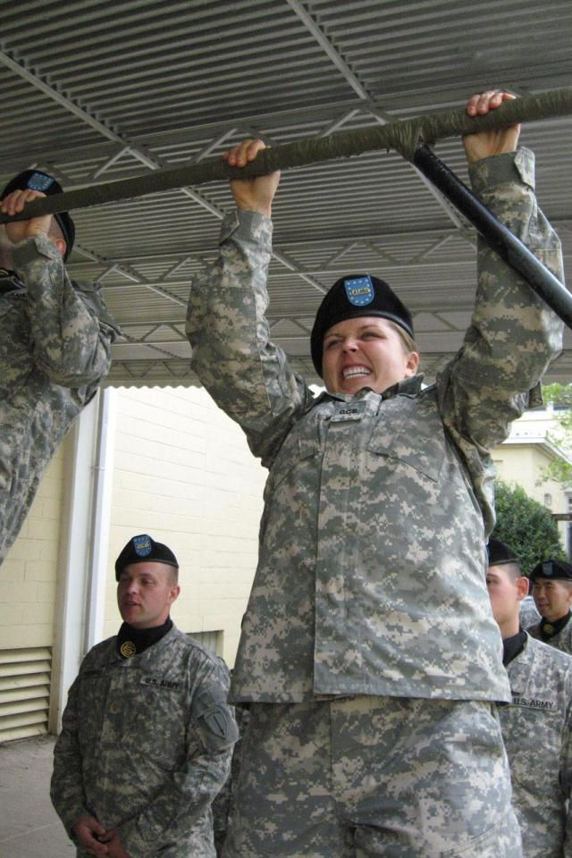 Officer Candidate Alicia Ingoglia, from Bravo Company, 11th Infantry Regiment, grits out another pull up before entering the dinning facility on Fort Benning, Ga., April 3, 2008. Candidates must do one pull up for each week of training they have completed before they can enter the facility.