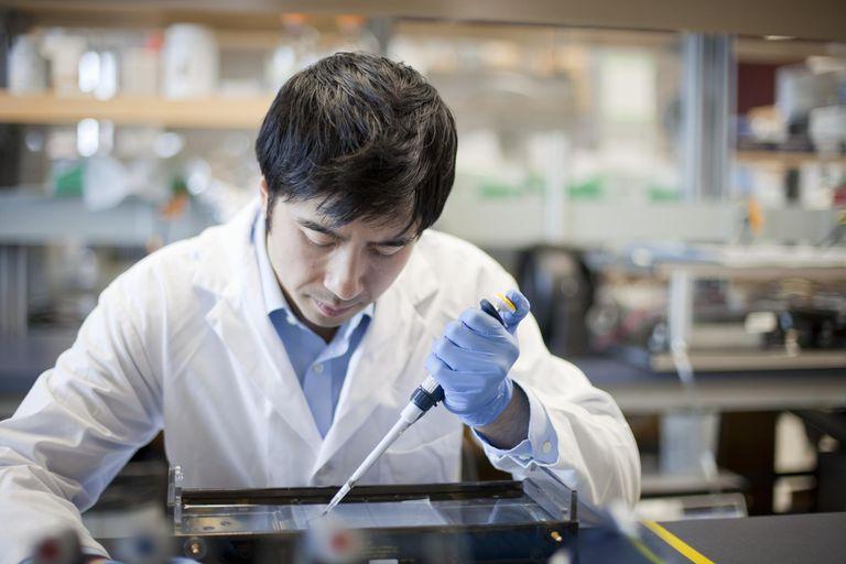 Laboratory technician uses micro-pipette