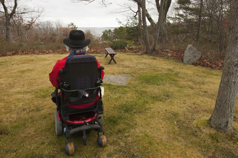 Man with Multiple Sclerosis in a motorized wheelchair in his yard