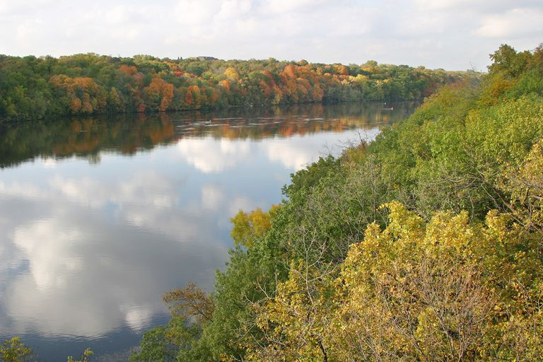 Trees And Clouds Reflecting On Mississippi River During Autumn