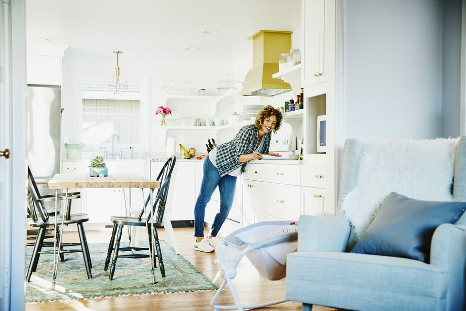 Laughing woman in home kitchen