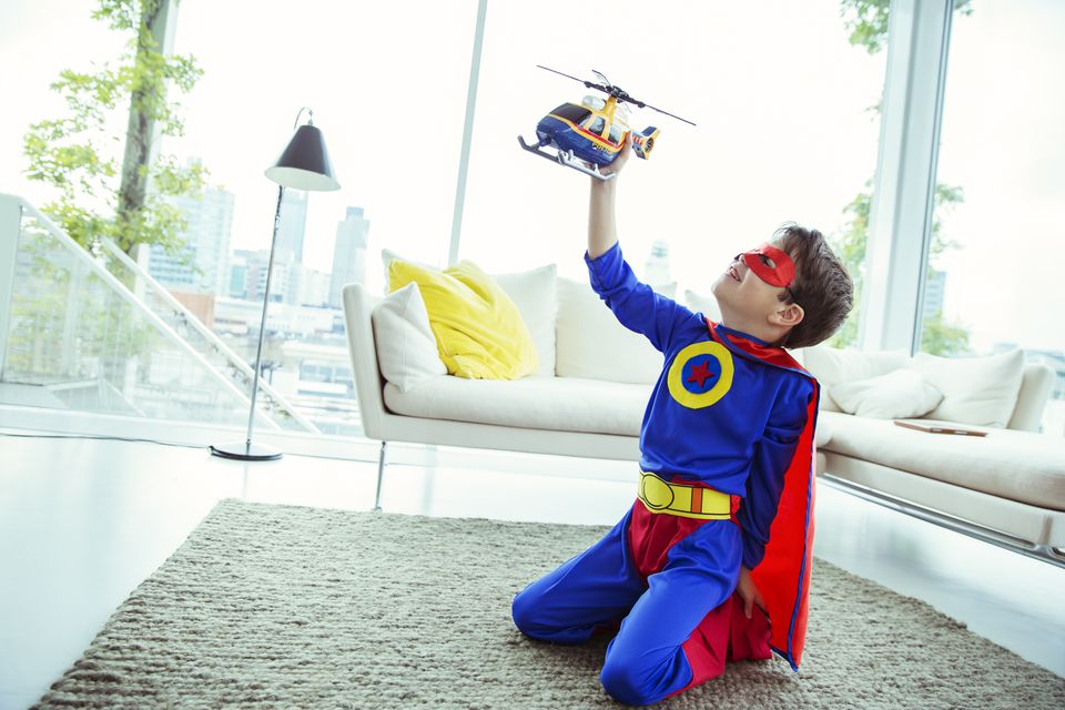 Superhero boy playing with helicopter