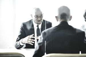 Businessman leading discussion during meeting