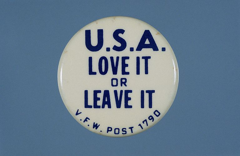 """A button bearing the slogan, """"U.S.A. Love it or leave it."""""""