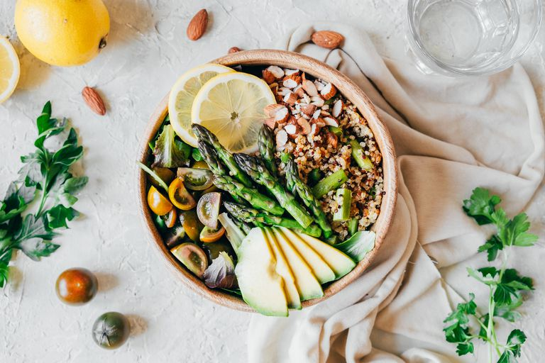 Quinoa bowl with asparagus, avocado, tomatoes and almonds
