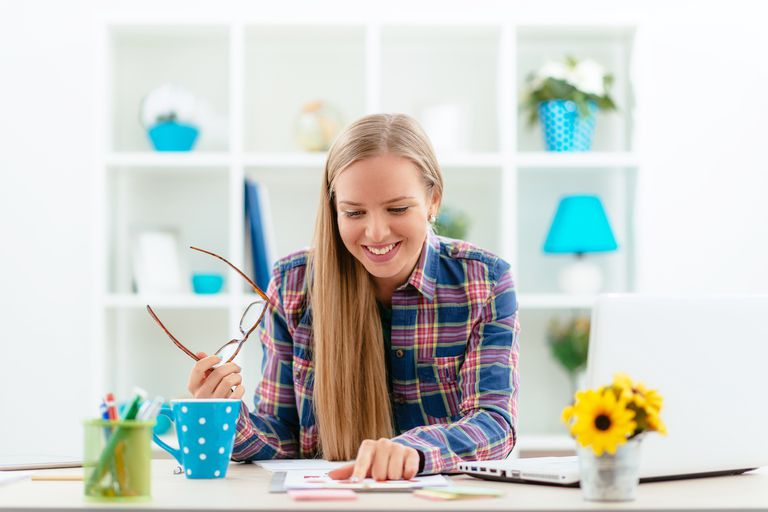 Young Scandinavian businesswoman analyzing statistics on stock market