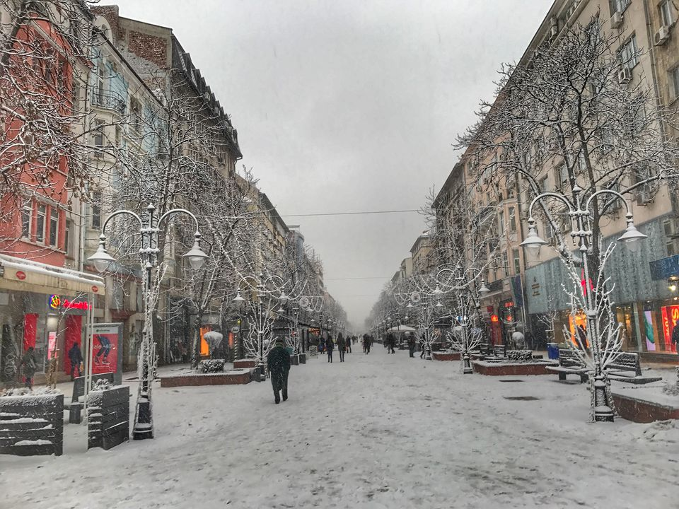 People On Snow Covered Vitosha Boulevard Amidst Buildings In City