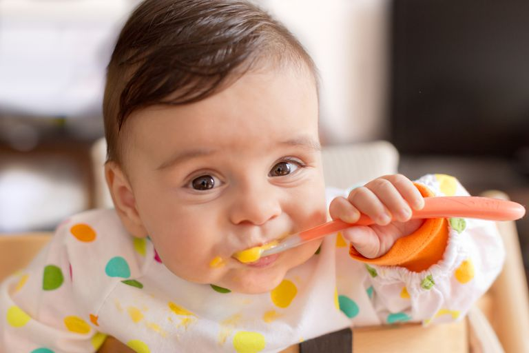 Baby eating with a spoon