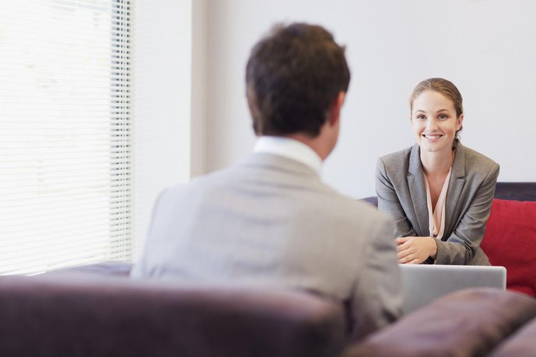 Woman and man in business attire talking