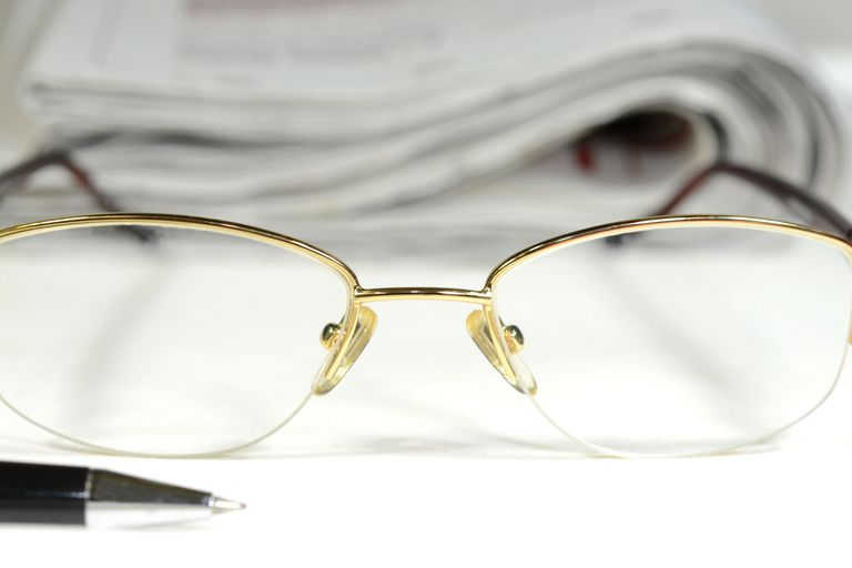 Eyeglasses and Newspaper