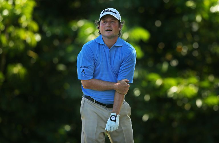 Golfer Tim Clark holds his injured elbow during the PGA Tour Sony Open tournament