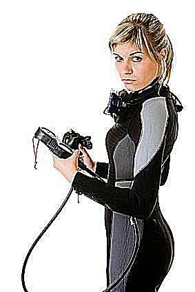 female blond scuba diver sets up her scuba diving gear.