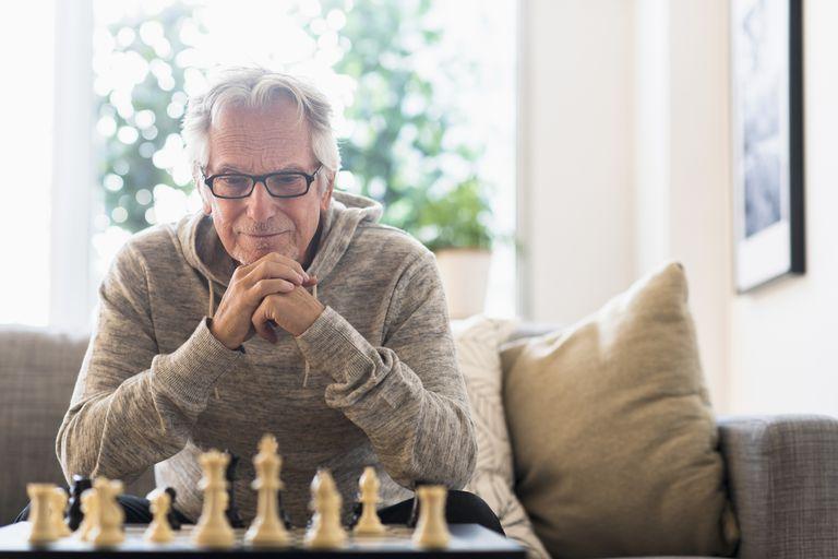 Senior man looking at chess board