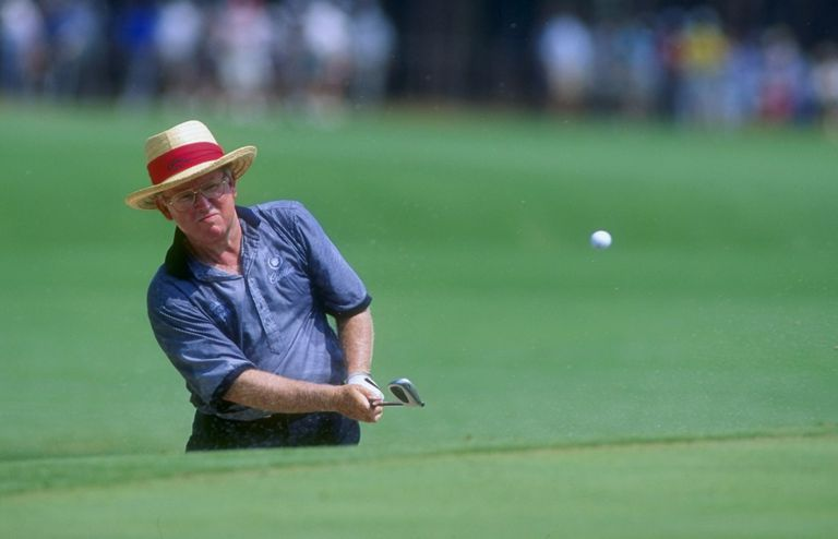 Bob Murphy hits a chip shot during the 1994 US Senior Open golf tournament