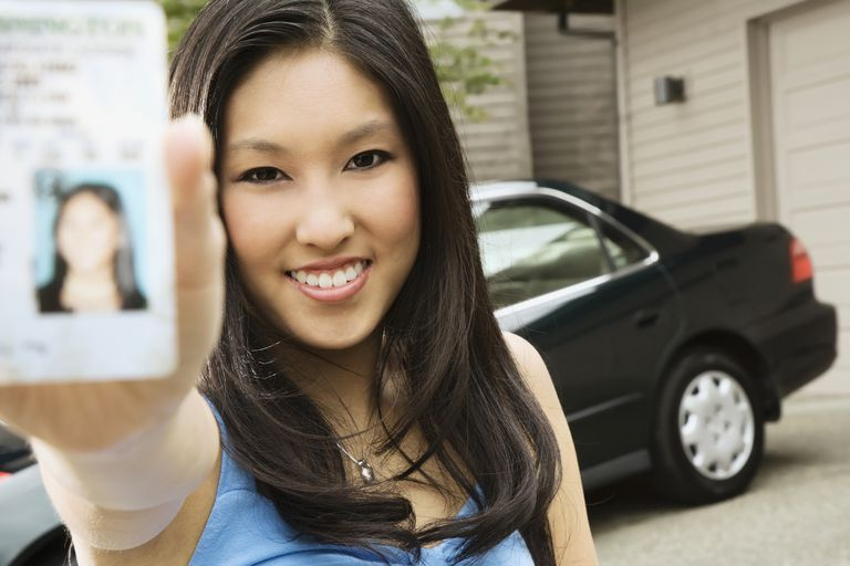 woman holding drivers license