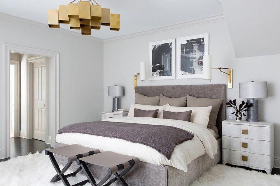 Brass chandelier in bedroom