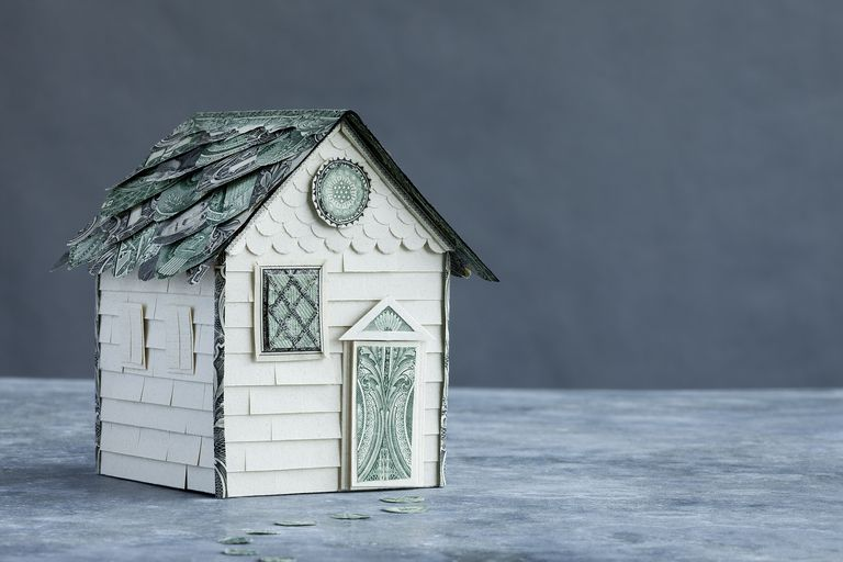 House model made of money on grey