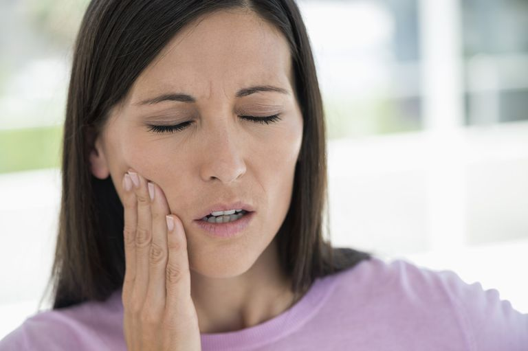 Woman suffering from a toothache