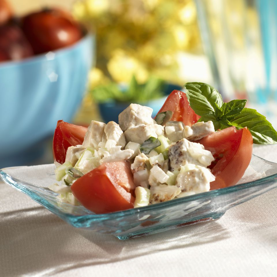 Chicken salad over fresh tomatoes, close up