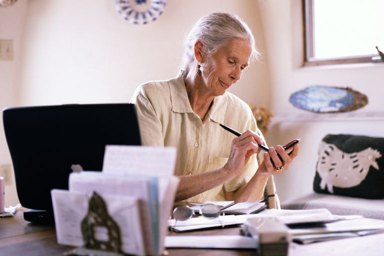 Elderly woman in office