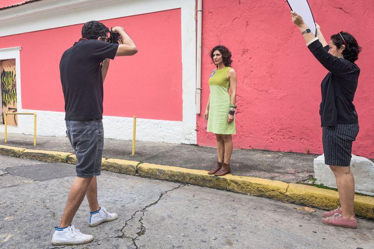 Man taking photo of female model outside