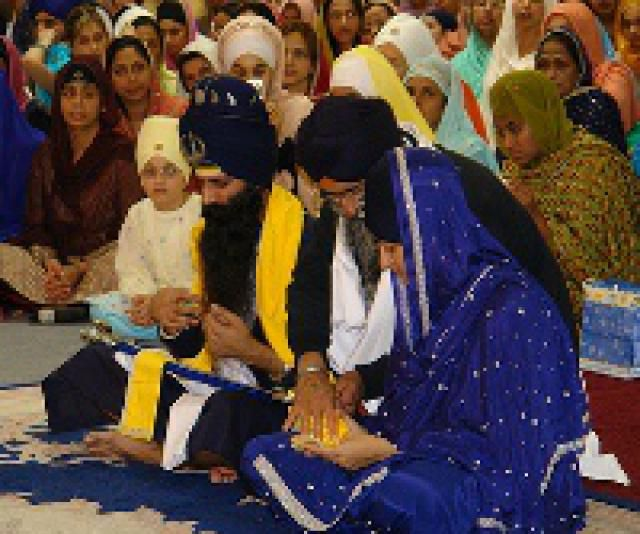 Bride and Groom sit together during a Sikh wedding ceremony.