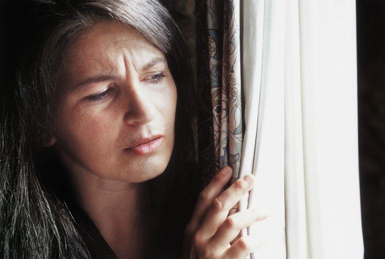 Woman peeking out the window