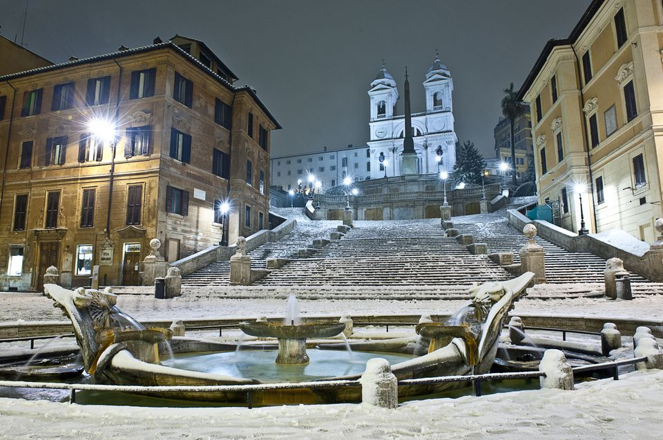 Italy, Rome, Night view with snow of Fontana della Barcaccia (Fountain of the Old Boat)