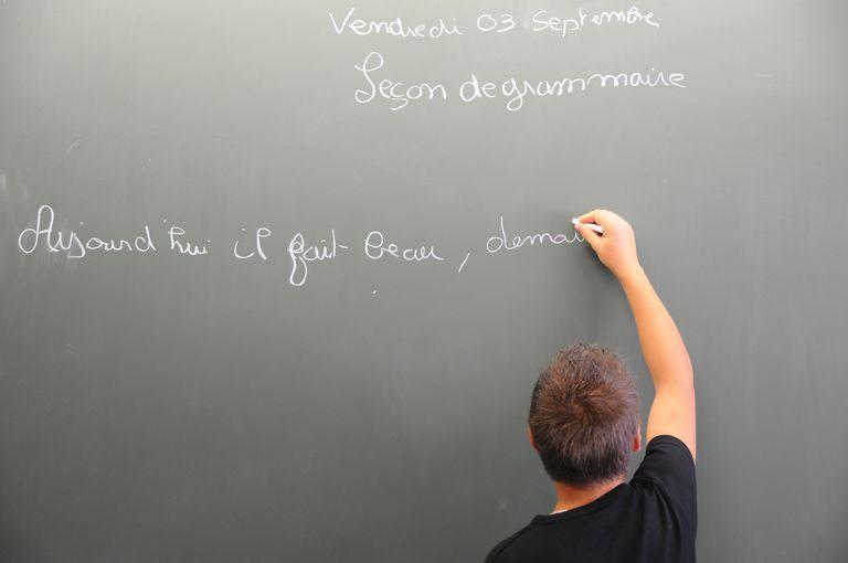 Boy writing on the blackboard