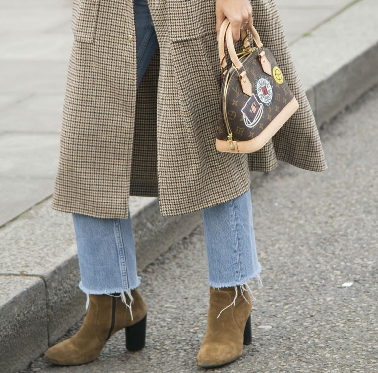 Street style in frayed raw hem jeans