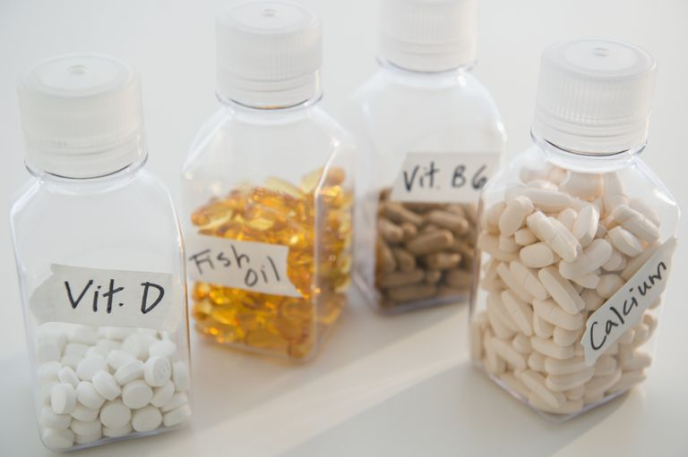 bottles of vitamin D, fish oil, vitamin B6, and calcium