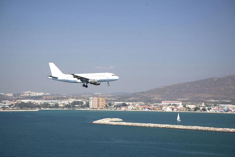 Airliner landing in a resort area.