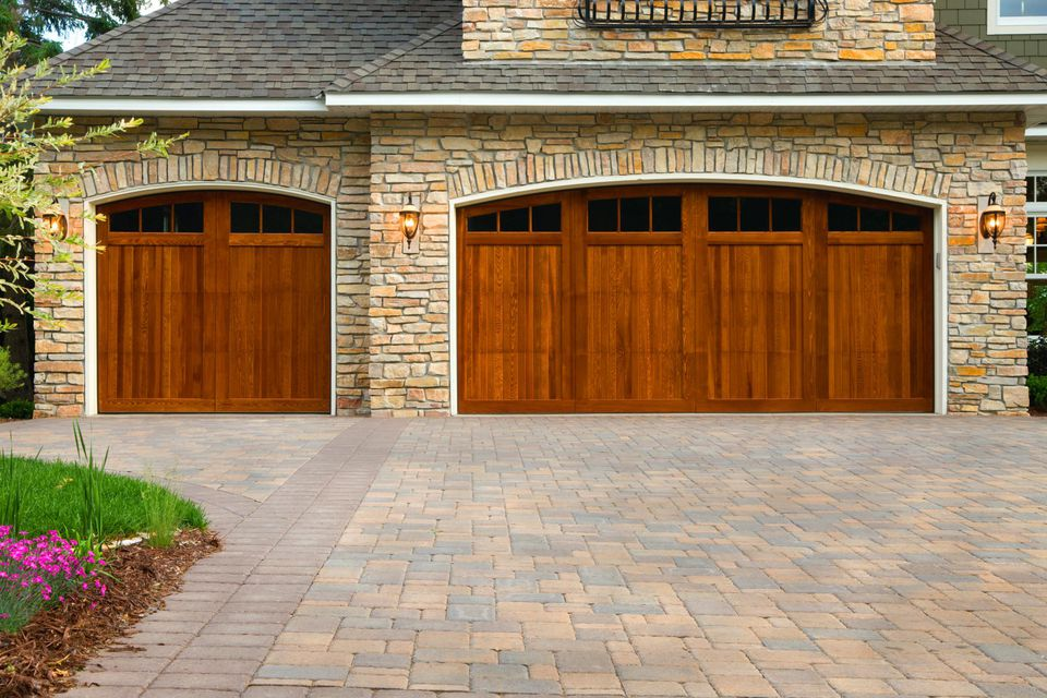 Pros and cons of a concrete driveway pavers pavers custom doors and stone on upscale home solutioingenieria Choice Image