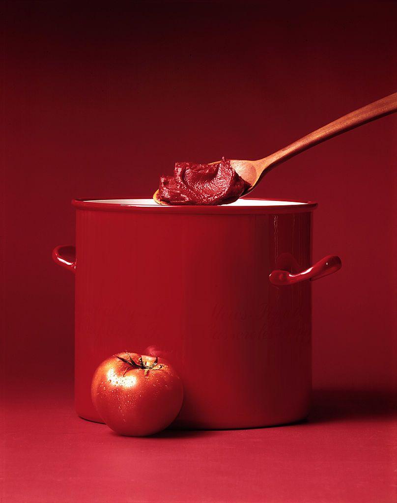 Tomato With Tomato Paste In Wood Spoon