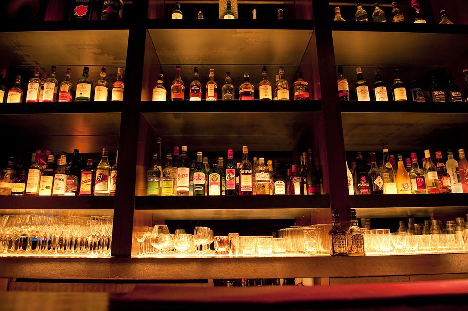 Liquor bottles behind a bar