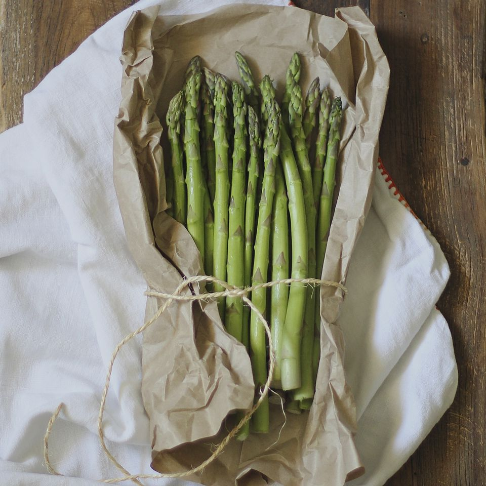 asparagus wrapped in parchment on a table