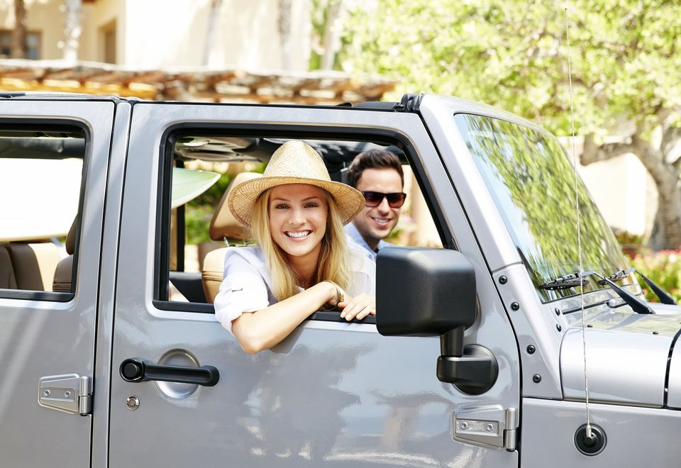 A couple in a jeep driving outdoors