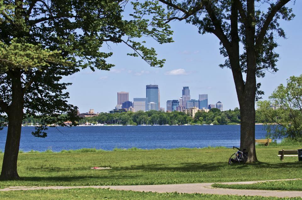 Minneapolis, Skyline over Lake Calhoun framed by trees