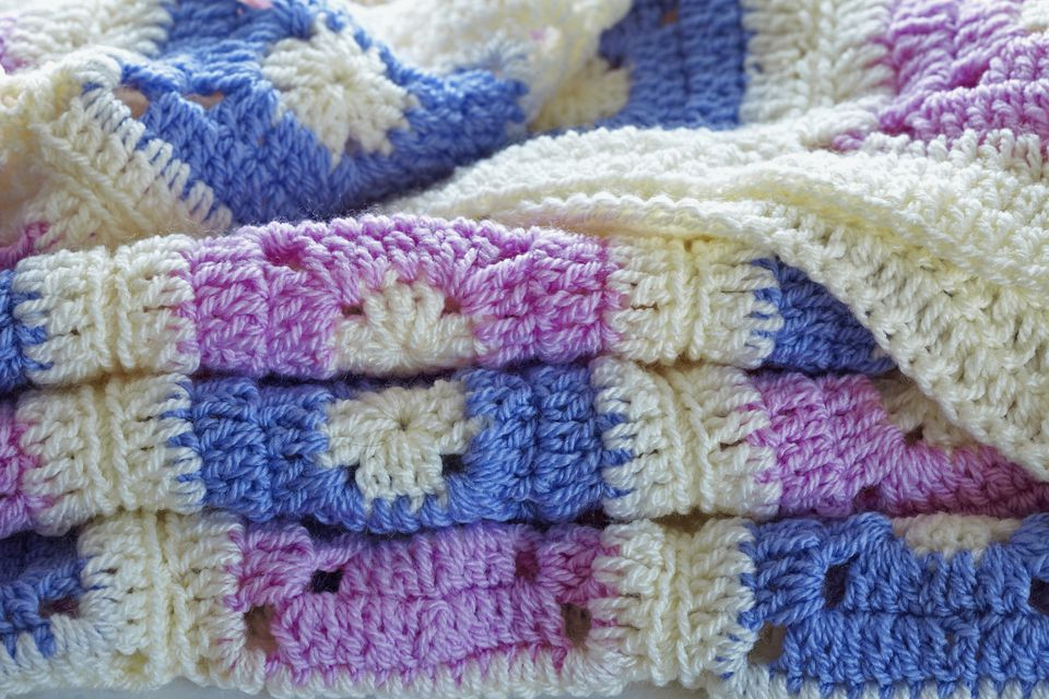 Crocheted patchwork throw, folded up