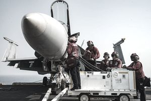 U.S. Navy, Aviation Ordnancemen load ordnance into an F/A-18E Super Hornet