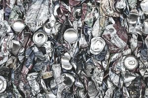 Mass of aluminium cans being processed at a recycling plant.