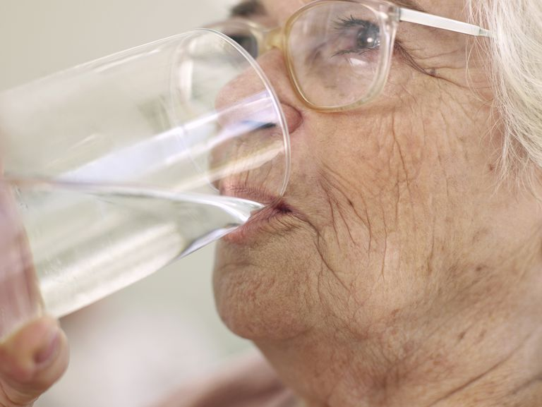 old woman drinking water